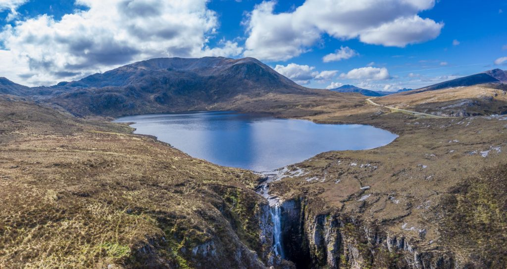 Waterfall Loch Na Gainmhich, The Wailing Widow Falls is a spectacular waterfall in the Scottish Highlands that can be viewed from both above and below.